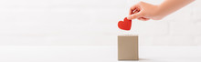 Cropped View Of Female Hand Putting Red Heart In Box On White Background, Donation Concept