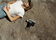 Woman Laying On Rock With Supe...