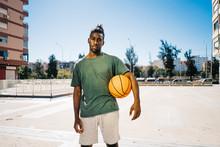 Basketball Players Standing On...