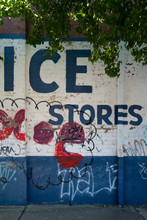 The Words ICE SALES Painted On Old Factory Wall