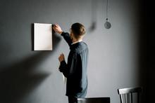 Male Designer Attaching Drafts...