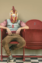 Rooster Masked Boy On Red Retro Cinema Chairs