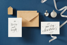 Christmas Greeting Card With Envelope On Blue Background