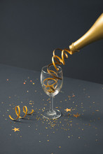 Champagne Bottle With Glass On Lights Background. New Year Concepts