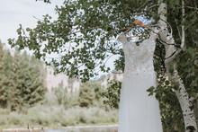 Wedding Dress Hanging On Branch
