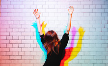 Woman Dancing Under Colored Li...