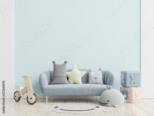 Blue sofa and doll,cute pillows in elegant child's room with mockup wall.