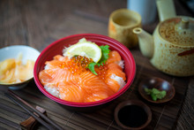Delicious Donburi Or Japanese Rice Bowl Topped Sashimi Salmon Roe And Fish Eggs On Bamboo Table.
