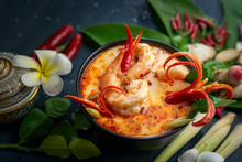 Tom Yum Kung In A Clay Pot Spicy Soup Traditional Thai Food Cuisine, Tom Yam Kung Spicy Thai Soup With Shrimp, Seafood, Coconut Milk And Herb.