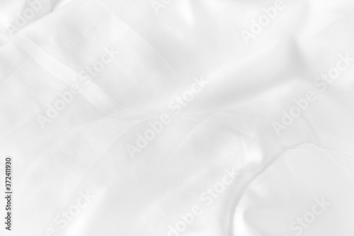 Close up top view of white bedding sheet and wrinkle messy blanket in bedroom after wake up in the morning Slika na platnu