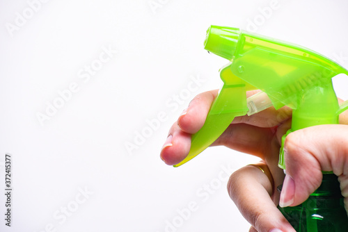 Hand holding plastic spray bottle - hold plastic spray bottle isolated on white Canvas-taulu