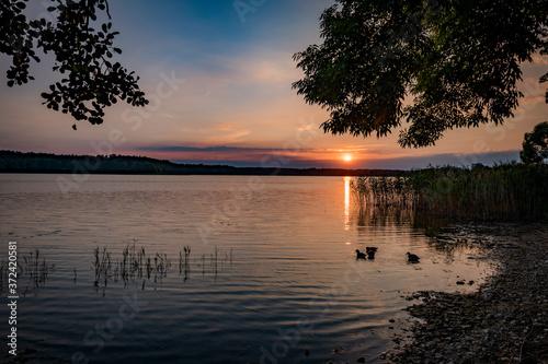 Fototapeta Zachód słońca nad Jeziorem Łaśmiady obraz
