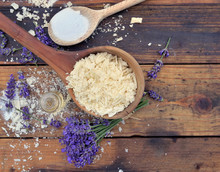 Spoon Full Of Flakes Of Soap With Essential Oil And Bunch Of Lavender Flowers