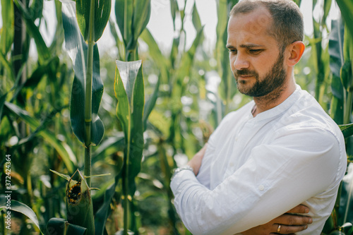 Wallpaper Mural Portrait of beautiful caucasian man with short dark hair in white shirt, blue je
