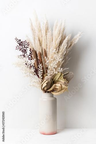 Fotografie, Obraz Stylish modern dried flower arrangement in a cream and pink vase