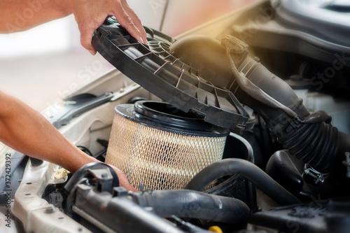 Fotografija Car mechanic working in repair garage