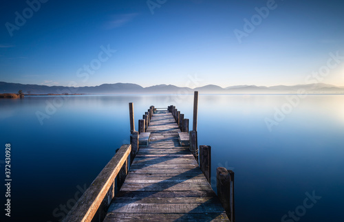 Fotomural Wooden pier or jetty at sunrise. Versilia Tuscany, Italy