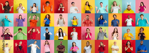 Fotografiet Collage of portraits of 38 young emotional people on multicolored background