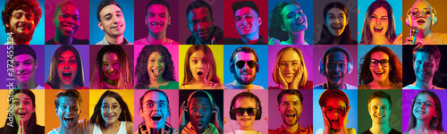 Collage of portraits of 23 young emotional people on multicolored background in neon Fototapet