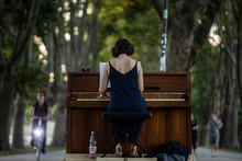 Street Artist Woman Playing Piano In German Park