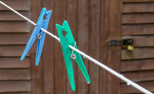 Blue Plastic Clothes Peg Hangs...