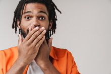 African Guy Covering Mouth Wit...