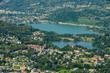 Aerial view of lake Muzzano and Lugano in Switzerland
