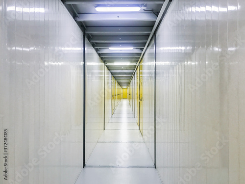 Obraz na plátně White corridor with yellow doors: storage sections