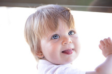Blue-eyed Blonde Baby With Ton...