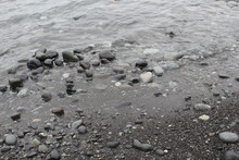 Waves Washing Over Pebbles
