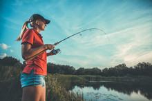 Cute Caucasian Woman Is Fishin...