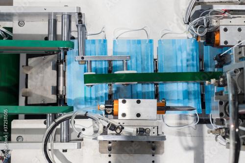 Leinwand Poster Production of medical masks - machine for the production of medical masks