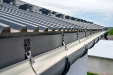 . Gutter System For A Metal Ro...