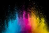 Fototapeta Tęcza - Colored powder explosion on black background. Freeze motion.