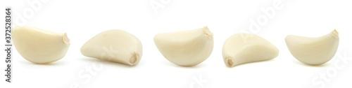 Leinwand Poster Garlic cloves on white. Set.