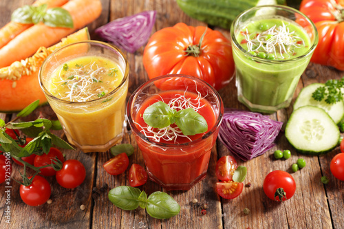 assortment of colored vegetable soup and fresh ingredient Fototapeta