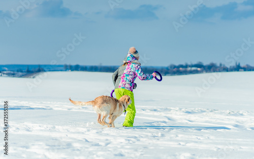 Photo Girl running in snow with dog