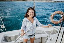 Smiling Female Sailor Driving ...