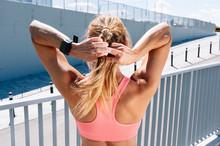 Sporty Woman Braiding Blond Ha...