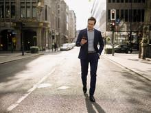 Mature Businessman Walking On ...