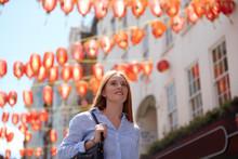 Thoughtful Young Woman Walking...