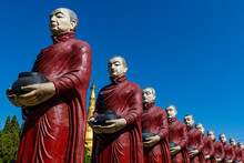Myanmar, Kachin State, Aung Zay Yan Aung Pagoda, Staues Of Monks With Alms