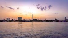 Egypt, Cairo, Cairo Tower On Gezira Island Seen Across River Nile At Sunset
