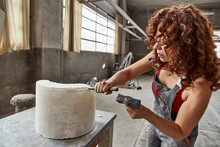 Female Stonemason With Curly H...