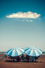 Two Sun Umbrellas On A Beach I...