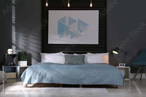 Fototapeta Comfortable bedroom with picture on decorative wall