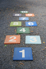 Colourful Hopscotch Playground Markings Numbers On Stone At Pavement