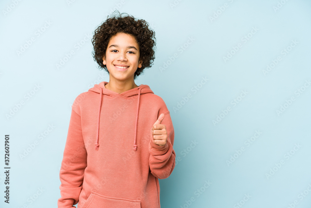 Fototapeta African american little boy isolated smiling and raising thumb up