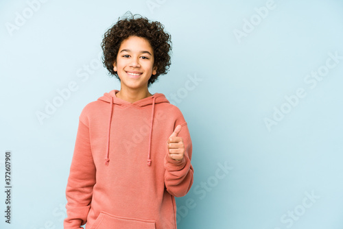 African american little boy isolated smiling and raising thumb up Fototapeta