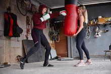 Sportswomen Punching Bag Durin...